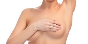 Cropped image of a female controlling breast for cancer, isolated on white background